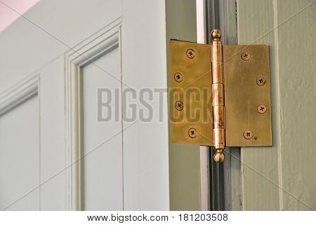 Wooden door metal hinges in the room