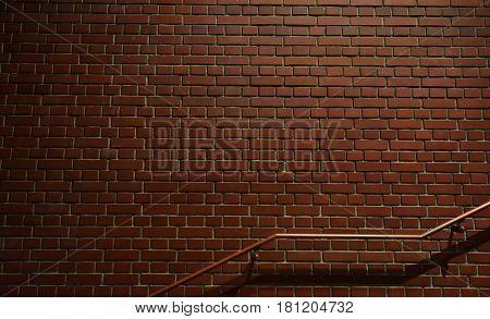 Night view of brick wall and stairway railing