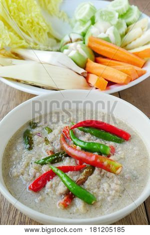 Soya bean dipping sauce with pork in coconut milk original Thai food. Served with fresh vegetables.