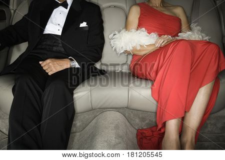 Senior African couple in backseat of limousine