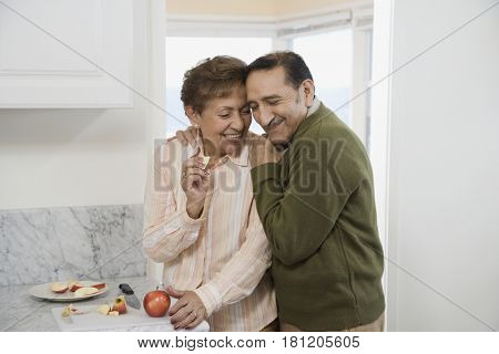Senior Hispanic couple hugging