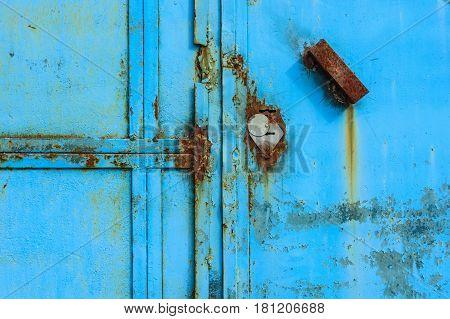 Close up of obsolete weathered rusty metal door