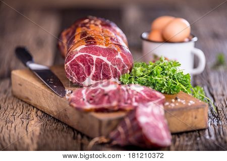 Pork meat.Pork chop smoked. Traditional smoked meat on oak wooden table in other positions.