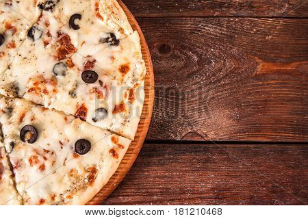 Junk food, bad habits. Pizza with olives and cheese on wooden table, flat lay with free space for text. Italian cuisine concept