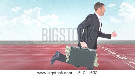 Digital composite of Business man with money sticking out of briefcase on track against sky