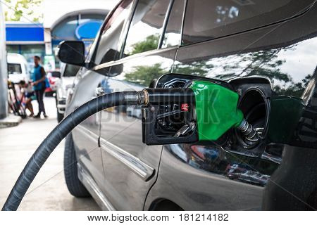 Close up, Car refueling on petrol station. Fuel pump with gasoline.