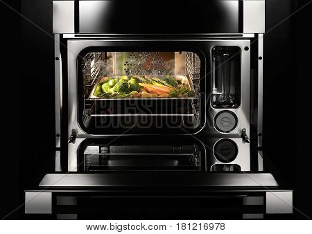 vegetable dish cooked  in the modern inox oven