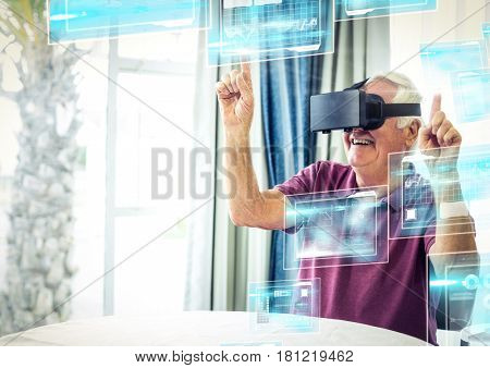 Digital composite of Old man happy wearing VR Virtual Reality Headset with Interface