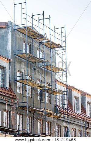 Apartment Building Under Construction. Scaffolding On Building Wall.