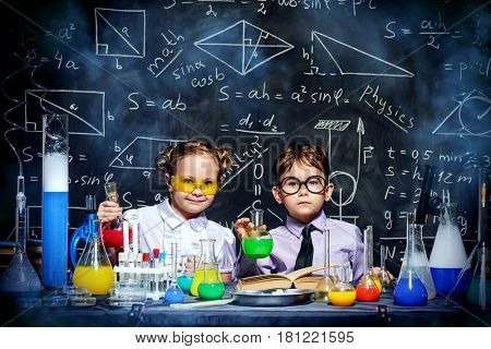 Two little children scientists making experiments in the laboratory. Educational concept. Early development of children.