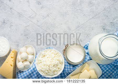 Dairy products. Cottage cheese, Sour cream, milk, egg, cheese and butter. Top view with copy space