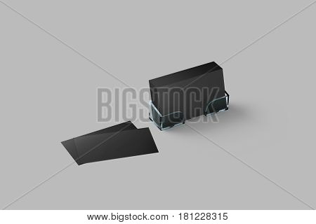 Black business card mockup in acrylic holder isolated with grey blank name cards. Cardholder branding identity mock up presentation.
