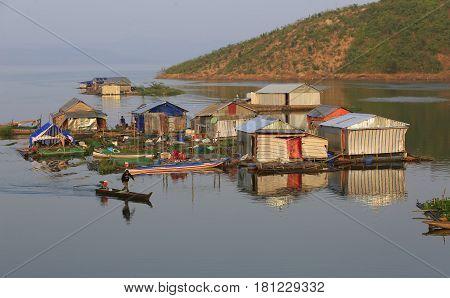 Dak Lak, Vietnam, March 12, 2017: Group of floating house and boat on Nam Ka fishing village.