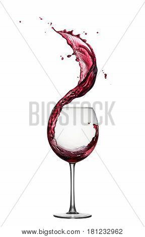glass of splashing red wine isolated on white
