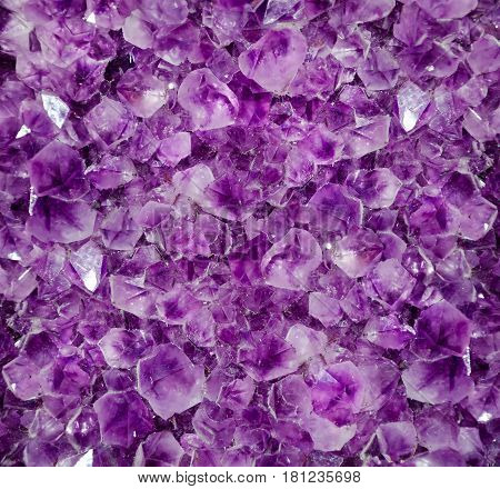 Natural amethyst crystal background. Amethyst is a violet variety of quartz