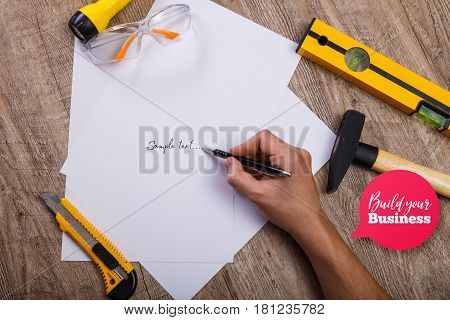 Hammer, knife and protective glasses. Build your business speech bubble. Flashlight, building level and blank sheets of paper.