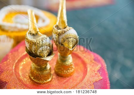 Thai Style Wedding, Two Golden Conch Shell Use For Pour Water To Married Couples Hand And Bless Them