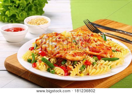 Grilled Chicken Breasts And Pasta On Plate