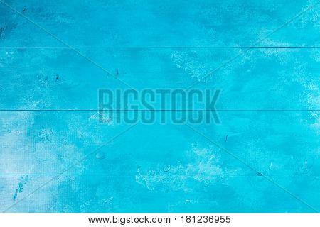 Bright aqua blue wooden background texture macro
