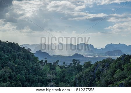 Beautiful Mountain Forest View With Haze Fog Cloud And Blue Sky For Nature Background.