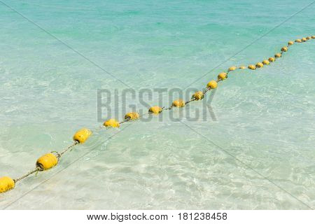 Sea Beach With Yellow Buoys, Safety Swimming Zone Separator, Thailand Ocean Travel Background.