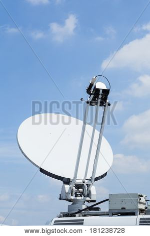 Satellite dish mounted mobile vehicle communication outdoor.
