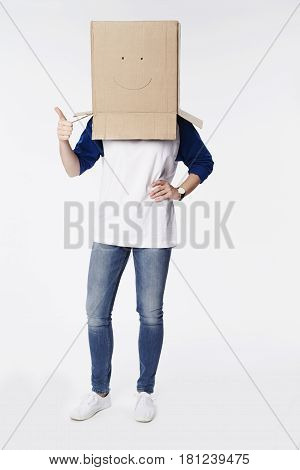 Cardboard box with smiley face on model