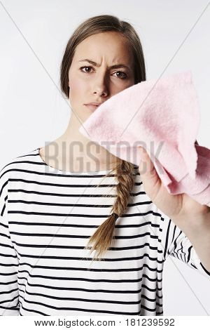 Cleaning young woman with pink duster portrait