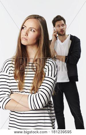 Sullen girl ignored by boyfriend on phone
