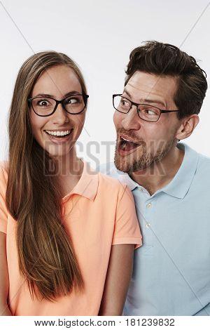 Couple smiling and messing around having fun studio