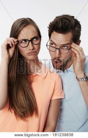 Kooky couple thinking hard fun studio shot