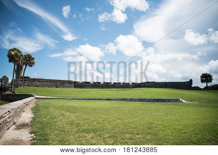 landscape view of field, fort, and sky of st. augustine in florida