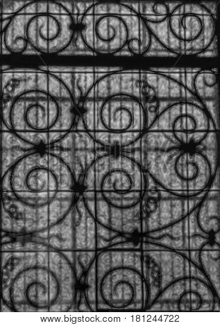Picture of a twisted metal window grille through a patterned glass