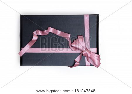 Black gift box with bow isolated on white background