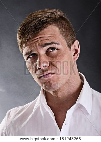 Portrait of a surprised and incredulous man on a black background