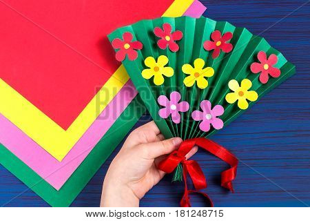 Making gift for Mother's Day by the child. Colorful bouquet of flowers out of paper. Children's art project. DIY concept. Step-by-step photo instruction. Step 7. Final result
