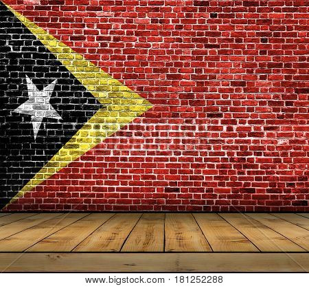 East Timor flag painted on brick wall with wooden floor