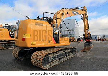 LIETO FINLAND - MARCH 25 2017: Cat 318FL Hydraulic excavator and other Cat construction equipment seen at the annual public event of Konekaupan Villi Lansi Machinery Sales.