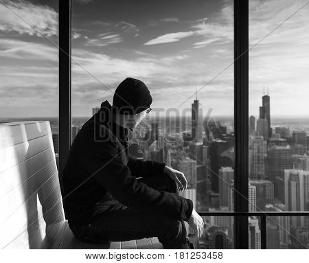 A Asian Man looking at Chicago City