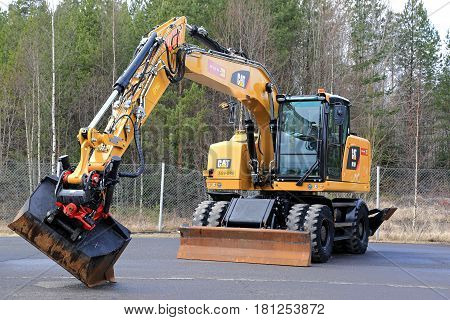 LIETO FINLAND - MARCH 25 2017: Cat M318F wheeled excavator on asphalt yard as seen at the public event of Konekaupan Villi Lansi Machinery Sales.
