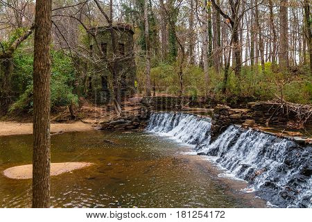 Spillway waterfall and the tower in the Lullwater Park Atlanta USA