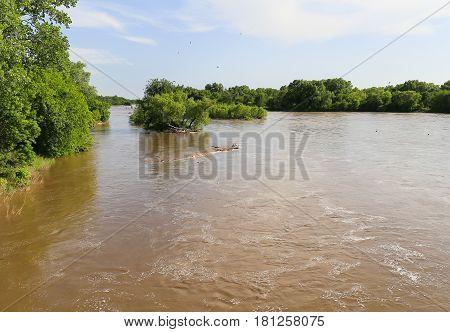 The Arkansas River near Mulvane Kansas with high water due to heavy rain.