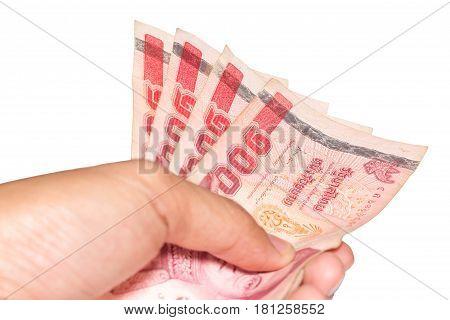 hand giving banknotes thailand 100 baht banknotes