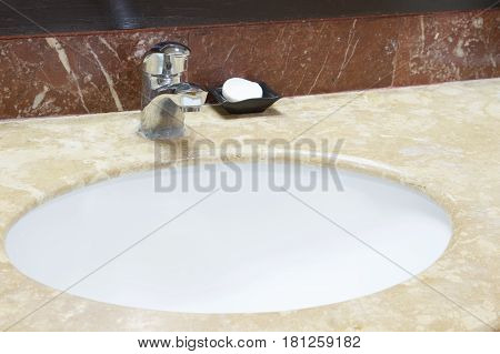 Chromium Faucet And White Soap With Basin And Marble