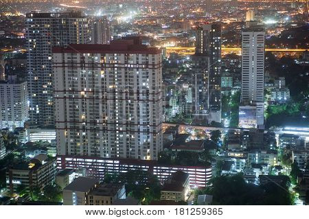 Condominium And Skyscrapers At Night In Bangkok Thailand
