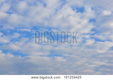 White altocumulus cloud in morning on the blue sky as background.