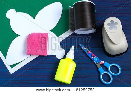 Making gift box by the child for Mother's Day. Children's art project. DIY concept. Step-by-step photo instruction. Step 1. Preparation of materials and tools (paper scissors glue puncher)