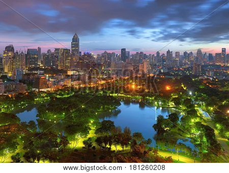 Lumpini Park at sunset in downtown Bangkok Thailand