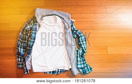 White T Shirt And Plaid Hipster Shirt On Wood Floor, Mock Up, Free Space