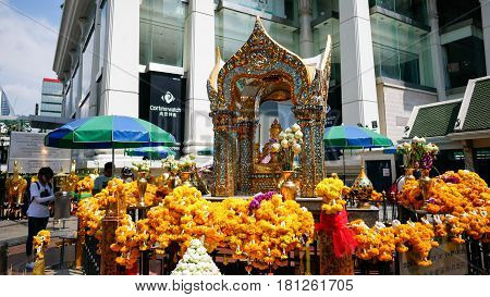 BANGKOK - MARCH 23: Buddhists worship the four-faced Brahma statue on March 23 2017 at Erawan Shrine in Bangkok. The Erawan Shrine is a Hindu shrine in Bangkok Thailand.